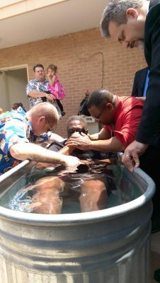 20160508_07-The brothers pray over Larry before they baptize him!