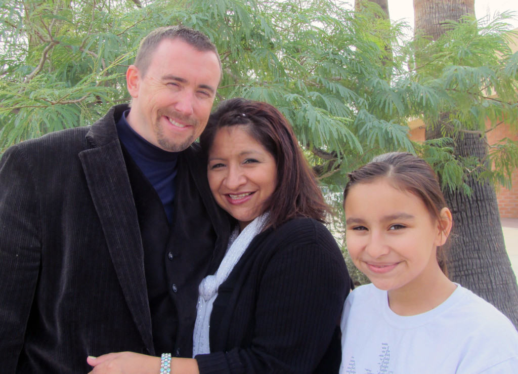 Dan and Laura Barrett pictured here with their daughter Cassie!  God has reunited and reconciled them with his family and one another with both of them being restored in 2013!