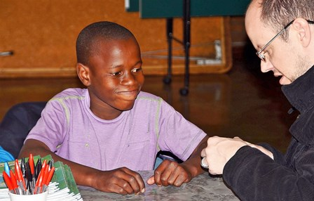 Johannesburg held a technical training session for children in a poverty stricken neighborhood called Squatters Village. Here, Jacques taught a young boy how to solder a transistor!