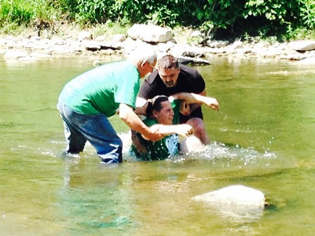 Harvey - with the help of Jake Studer - fulfills a dream and baptizes his son Andrew!