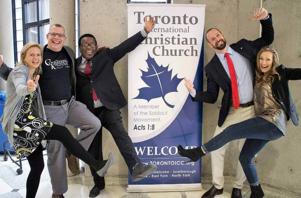 Ghislain and Debbie Normand (Left) gallantly join the Soldout Movement, as John Causey (Center) and Evan and Kelly Bartholomew joyfully welcome them to the Toronto ICC!